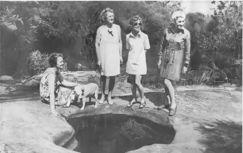 """""""The Battlers"""" standing next to Aboriginal Rock Pool: An essential freshwater source."""
